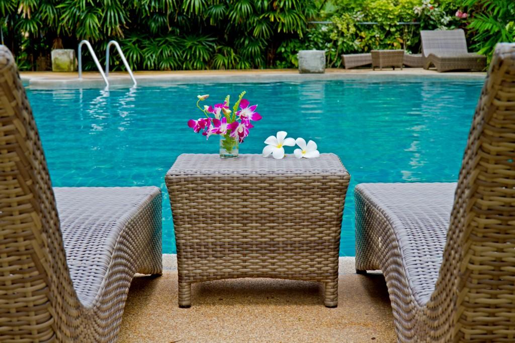 Rattan furniture beside the pool